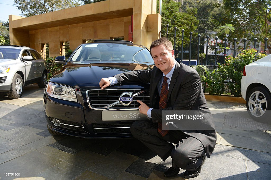 Managing Director, Volvo Auto India Tomas Ernberg poses in front of a Volvo S80 sedan class car during its launch in Ahmedabad on December 27, 2012.Swedish luxury car maker Volvo said that it was studying the possibility of setting up a car manufacturing plant in India as part of a drive to nearly double global sales. The company aims to increase worldwide sales to 800,000 vehicles by 2020, from a current 440,000 a year. AFP PHOTO/Sam PANTHAKY
