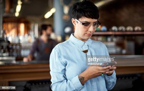 Managing her bar with some smart mobile apps