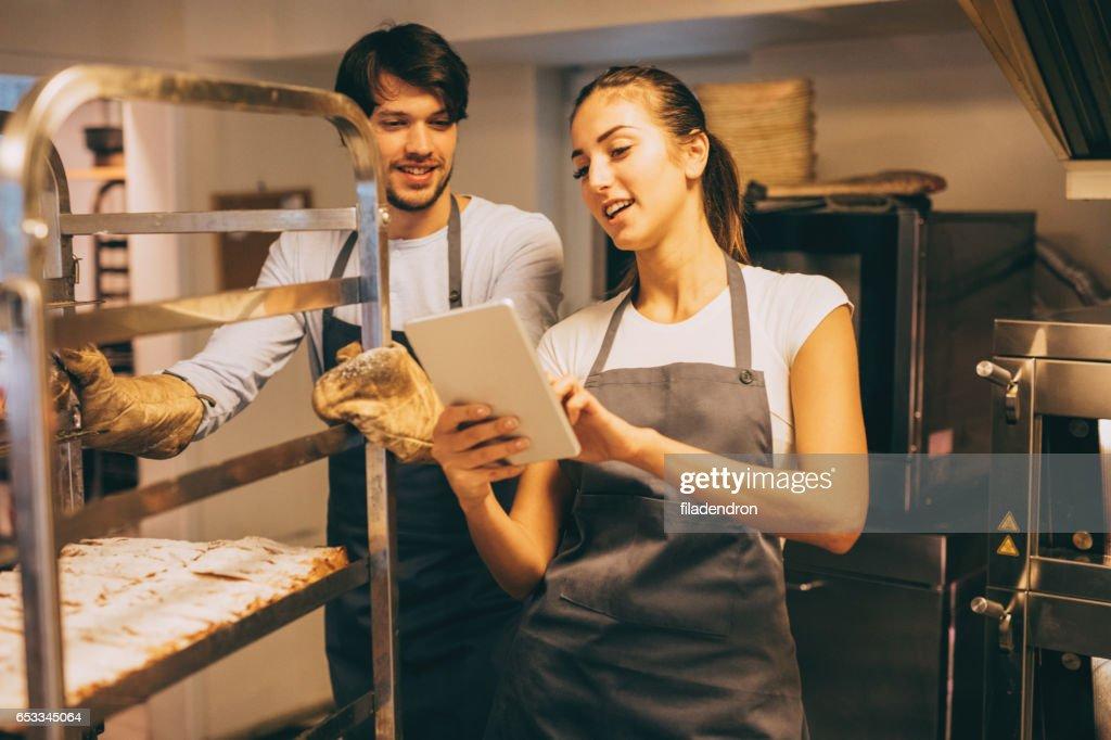 Managing the bakery : Stock Photo