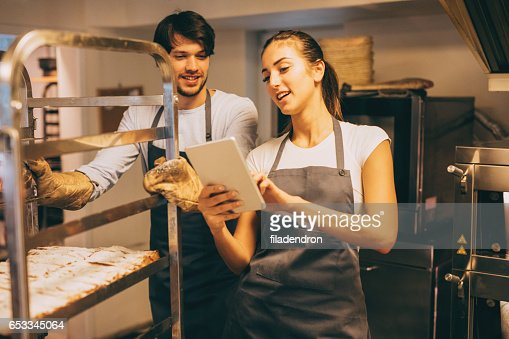 Managing the bakery : Stockfoto
