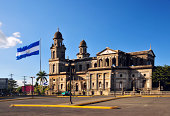 Managua, Nicaragua: south side of the Old Cathedral and the giant Nicaraguan flag flying at Plaza de la Revolución / Plaza de la República, built in concrete and steel and designed by the engineer Pab