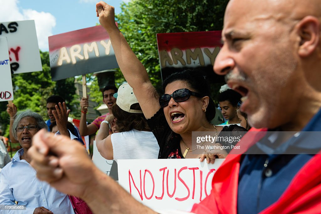 Manal Amin, 43, of Silver Spring, center, and Mahmoud Ashour, 53, right, of Falls Church, are pictured. A group of Egyptians protested outside the White House on Saturday July 6, 2013.