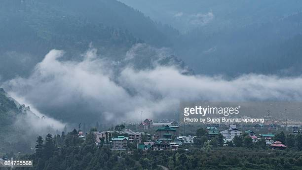 Manali valley in the morning fog , India