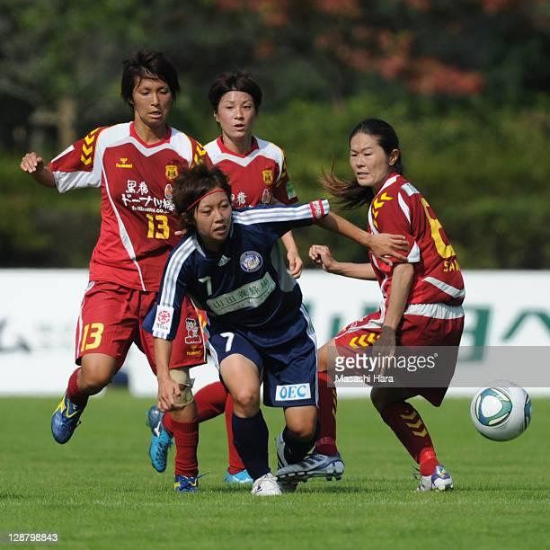 Manami Nakano of Okayama Yunogo Belle and INAC Kobe Leonessa players Chiaki MinamiyamaYukari KingaHomare Sawa compete for the ball during the...