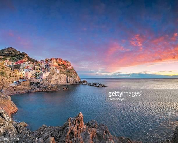Manarola at sunset, Cinque Terre National Park, Ligurian Riviera, Italy