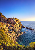 Manarola village on cliff rocks and sea at sunset., Seascape in Five lands, Cinque Terre National Park, Liguria Italy Europe.