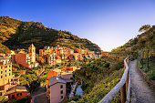 Manarola village, trekking trail, church and vineyard. Cinque Terre National Park, Liguria Italy Europe. Long Exposure