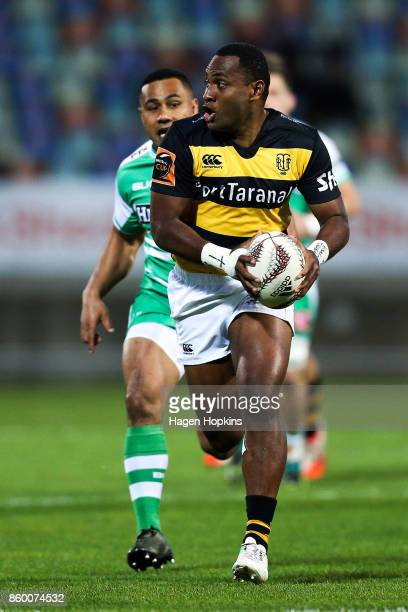 Manasa Mataele of Taranaki makes a break from Ngani Laumape of Manawatu during the round nine Mitre 10 Cup and Ranfurly Shield match between Taranaki...