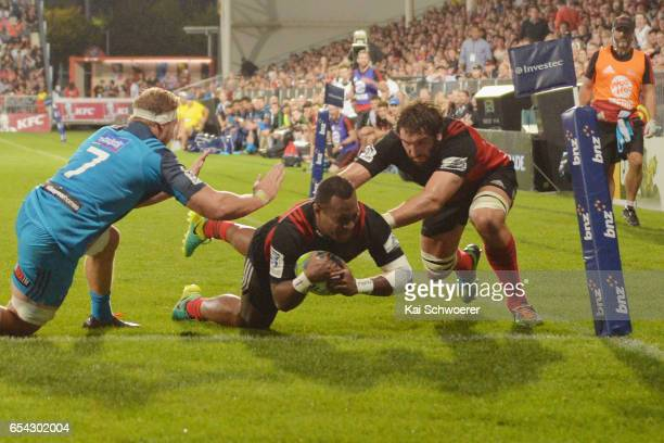 Manasa Mataele of the Crusaders dives over to score a try during the round four Super Rugby match between the Crusaders and the Blues at AMI Stadium...