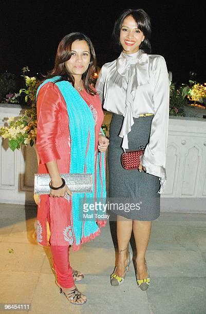 Manasi Joshi Roy with singer Mansi Scott at the Swarovski Save The Tiger charity auction in Mumbai on February 3 2010