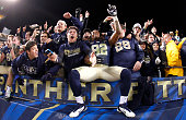 Manasseh Garner of the Pittsburgh Panthers celebrates with PITT students after defeating the Notre Dame Fighting Irish 2821 on November 9 2013 at...