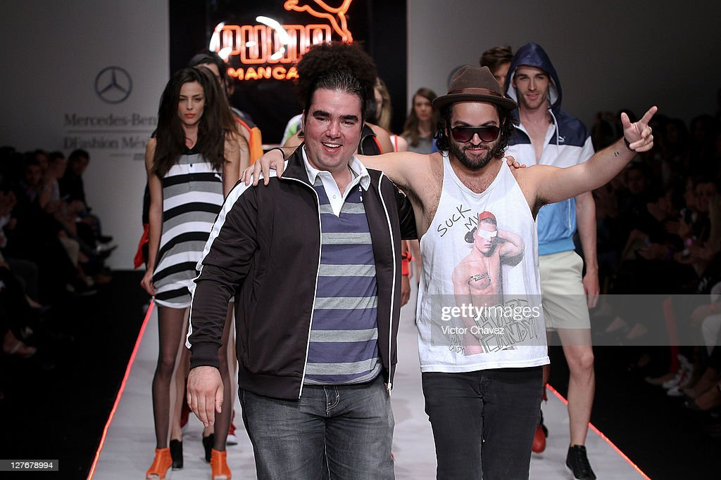 Mancandy fashion designer <a gi-track='captionPersonalityLinkClicked' href=/galleries/search?phrase=Andres+Jimenez&family=editorial&specificpeople=5498155 ng-click='$event.stopPropagation()'>Andres Jimenez</a> and Alberto Turincio walk the runway during Mercedes-Benz Dfashion Mexico Spring/Summer 2012 at Hipodromo De Las Americas on September 29, 2011 in Mexico City, Mexico.