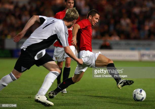 Mancherster United's Phil Bardsley holds off Dunfermline Athletic`s Calum Woods during the Friendly match at East End Park Dunfermline Fife