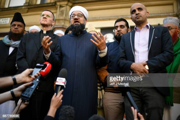 Manchester Central Park Mosque Imam Irfan Chishti speaks as Multicultural religious leaders from across Manchester hold a vigil in St Ann's Square on...