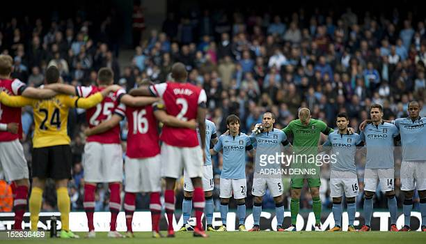 Manchester City and Arsenal players observe a minute's silence for two Police constables Fiona Bone and Nicola Hughes killed in the line of duty...