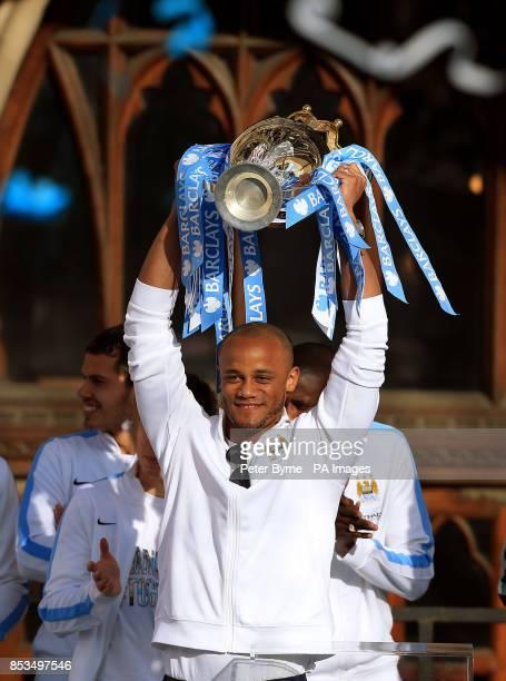 Manchester City captain Vincent Kompany lifts the Barclays Premier League Trophy during the Barclays Premier League Victory Parade in Manchester