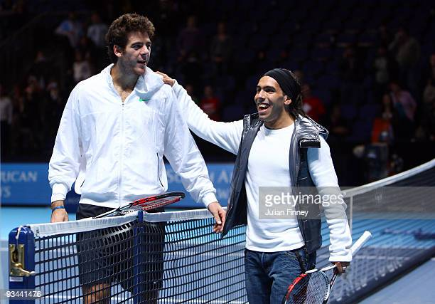 Manchester City Carlos Tevez poses for a picture with Juan Martin Del Potro of Argentina after Del Potro won his men's singles round robin match...