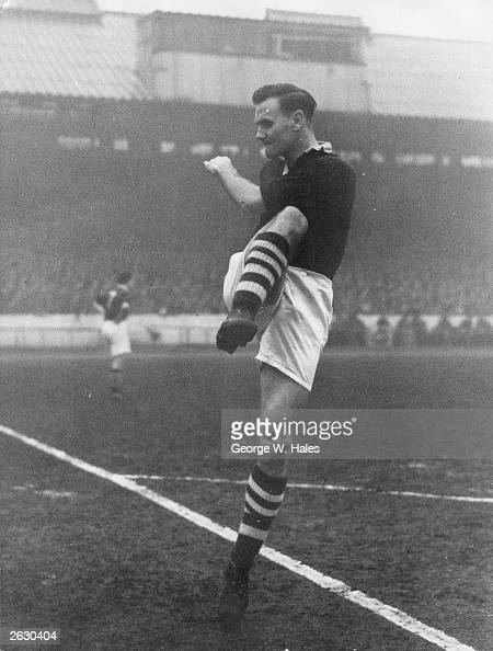 Manchester City centreforward Don Revie kicking the ball at Stamford Bridge during a match against Chelsea Original Publication Picture Post 7554 Don...
