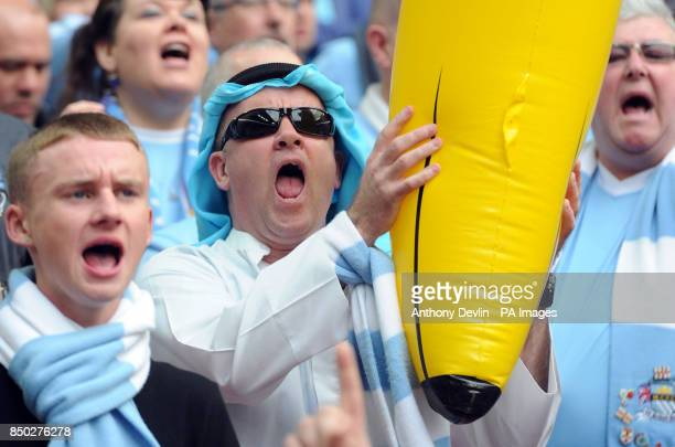 A Manchester City city fan in fancy dress