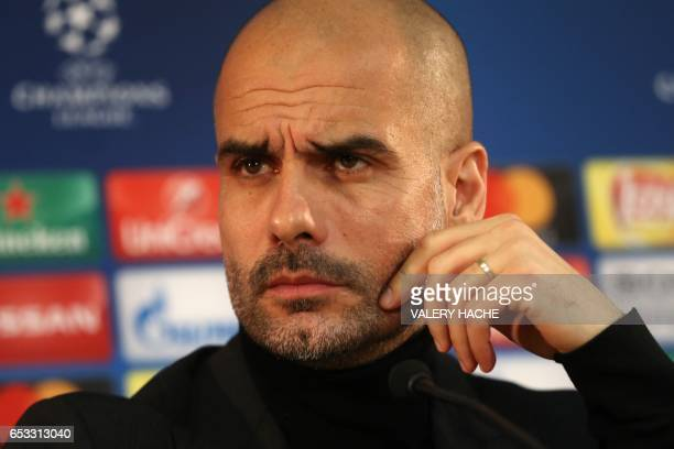 Manchester City coach Pep Guardiola speaks during a press conference in Monaco on March 14 on the eve of their UEFA Champions League football match...