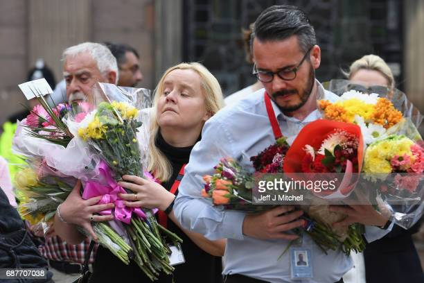 Manchester City Council workers move the floral tributes from Albert Square to St Anns Square on May 24 2017 in Manchester England An explosion...