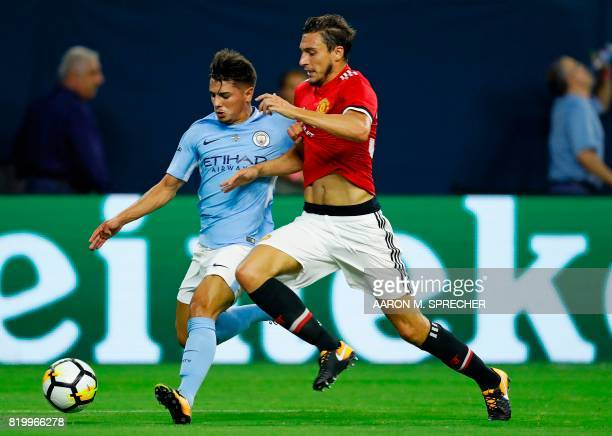 Manchester City defender Brahim Diaz and Manchester United defender Matteo Darmian vie for the ball during the International Champions Cup soccer...