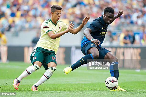 Manchester City defender Micah Richards makes a play with the ball while being covered by AC Milan forward Hachim Mastour during the second half of...