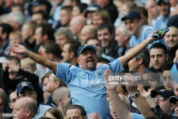 Manchester City Fan celebrates his Team's victory during the Barclays Premiership match between Manchester City and West Ham United at the City of...