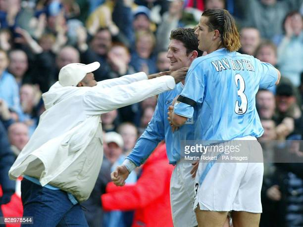 A Manchester City fan congratulates Jon Macken on scoring against Manchester United during the Barclaycard Premiership match at the City of...