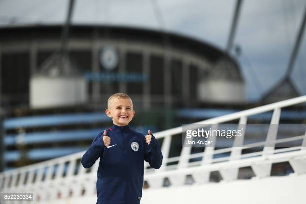 Manchester City fan enjoys the pre match atmosphere prior to the Premier League match between Manchester City and Crystal Palace at Etihad Stadium on...