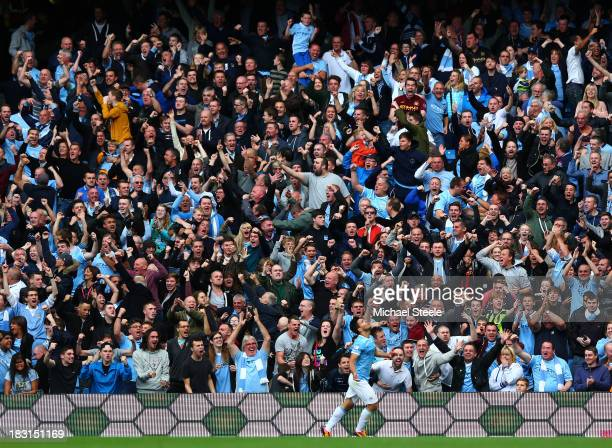 Manchester City fans celebrate after Sergio Aguero of Manchester City scores their team's second goal during the Barclays Premier League match...