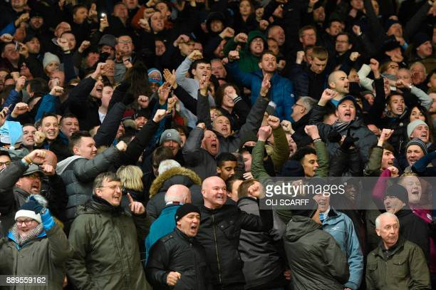 Manchester City fans celebrate after the final whistle during the English Premier League football match between Manchester United and Manchester City...