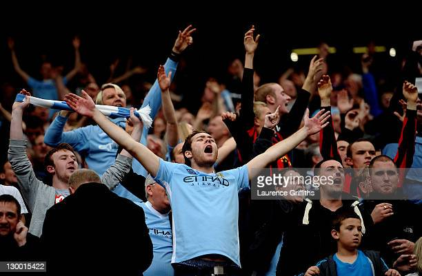 Manchester City fans celebrate during the Barclays Premier League match between Manchester United and Manchester City at Old Trafford on October 23...