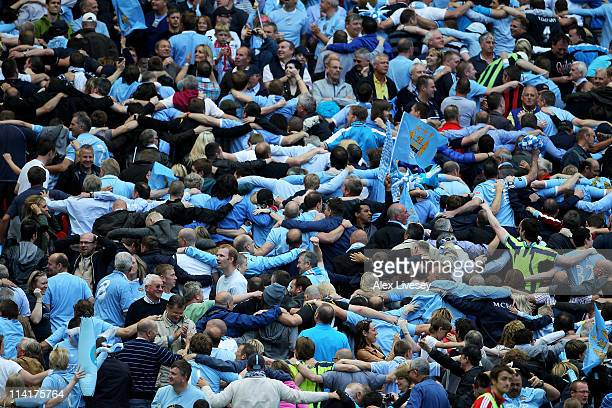 Manchester City fans celebrate the opening goal by doing the 'Poznan' during the FA Cup sponsored by EON Final match between Manchester City and...