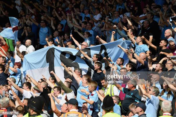 Manchester City fans celebrate their sides goal during the Premier League match between AFC Bournemouth and Manchester City at Vitality Stadium on...