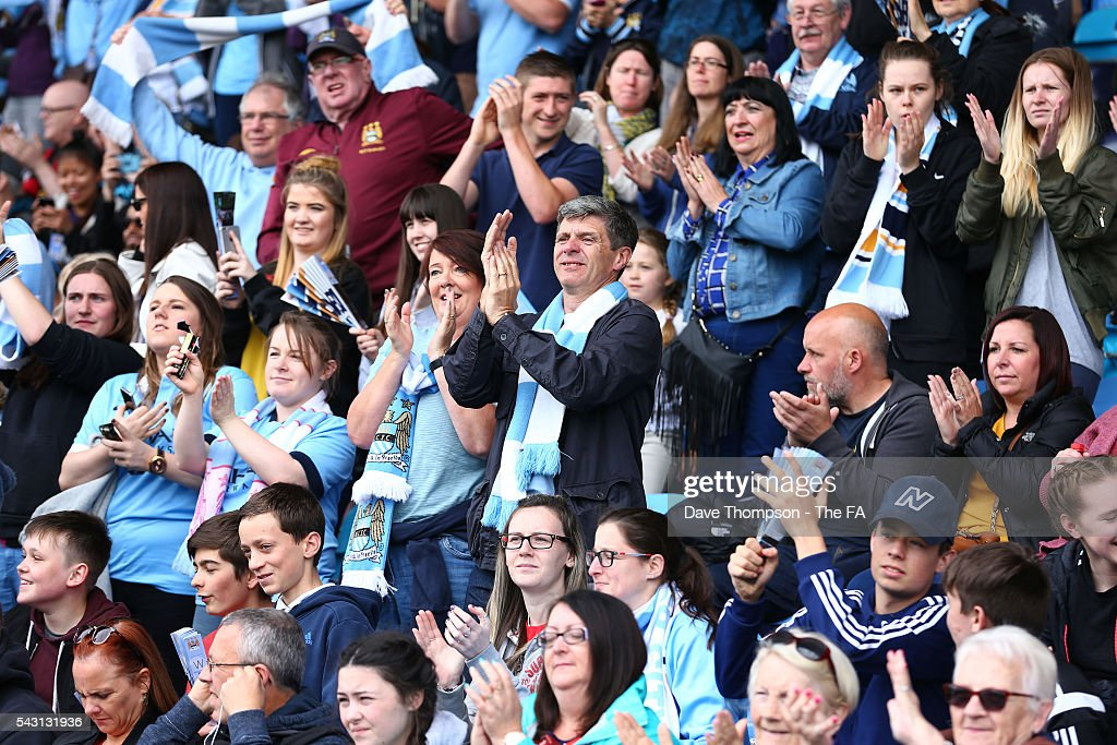 Manchester City fans cheer on their team during the FA WSL match between Manchester City Women and Liverpool Ladies FC on June 26, 2016 in Manchester, England.