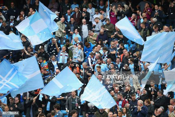 Manchester City fans cheer on their team during the Premier League match between Manchester City and Crystal Palace at Etihad Stadium on September 23...