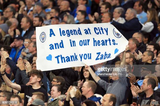 Manchester City fans hold a banner paying tribute to Pablo Zabaleta