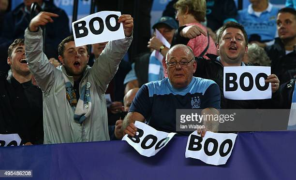 Manchester City fans holds up 'boo' signs the UEFA Champions League Group D match between Sevilla FC and Manchester City FC at Estadio Ramon Sanchez...