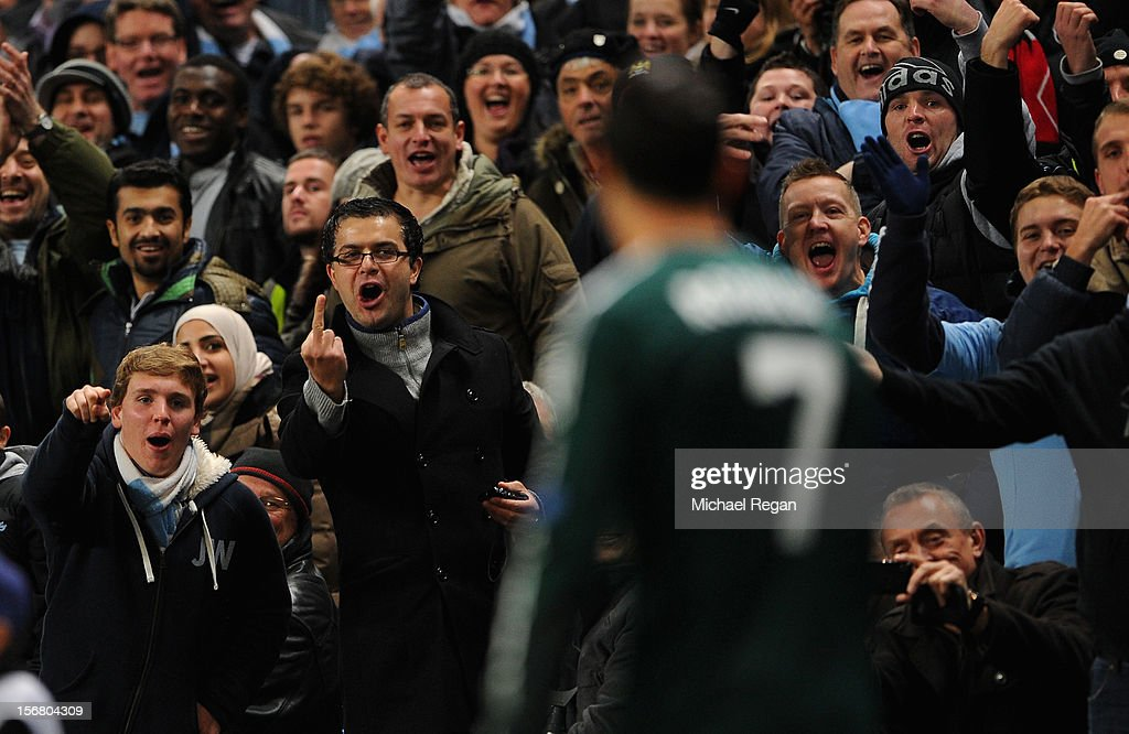 Manchester City fans react to <a gi-track='captionPersonalityLinkClicked' href=/galleries/search?phrase=Cristiano+Ronaldo+-+Soccer+Player&family=editorial&specificpeople=162689 ng-click='$event.stopPropagation()'>Cristiano Ronaldo</a> of Real Madrid during the UEFA Champions League Group D match between Manchester City FC and Real Madrid CF at the Etihad Stadium on November 21, 2012 in Manchester, England.
