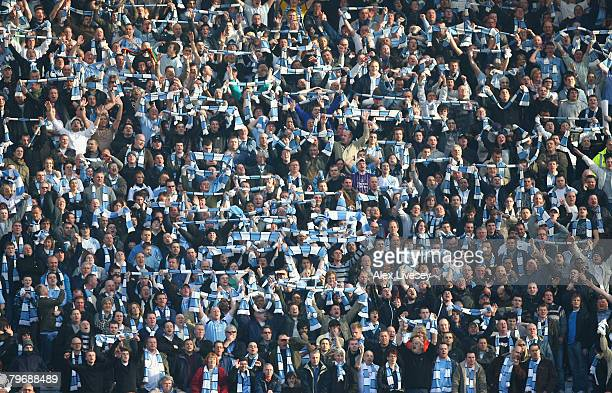 Manchester City fans show their support during the Barclays Premier League match between Manchester United and Manchester City at Old Trafford on...