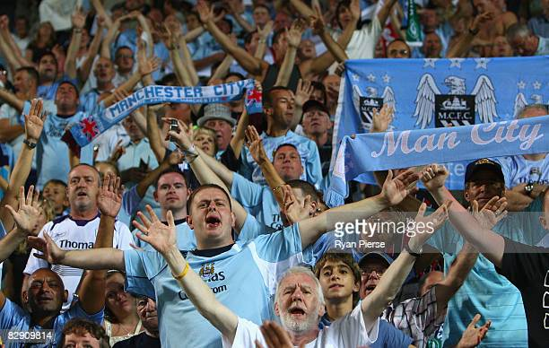Manchester City fans sing during the UEFA Cup first leg match between Omonia Nicosia and Manchester City at the GSP Stadium on September 18 2008 in...