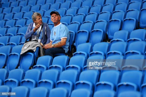 Manchester City fans sit in the stands before the Premier League match between Brighton and Hove Albion and Manchester City at Amex Stadium on August...