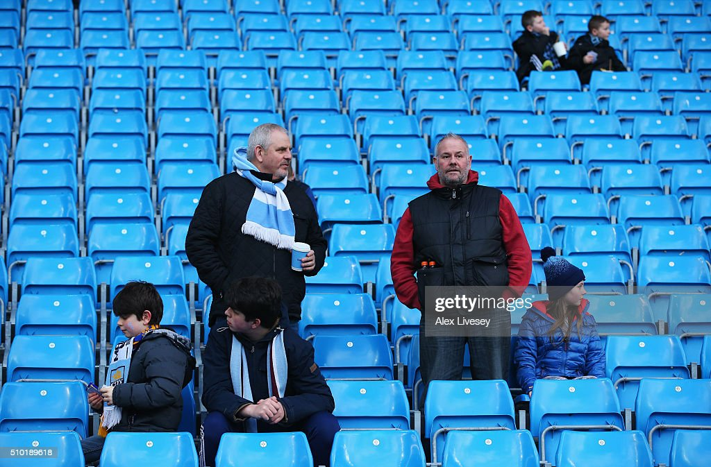 Manchester City fans take their seats prior to the Barclays Premier League match between Manchester City and Tottenham Hotspur at Etihad Stadium on February 14, 2016 in Manchester, England.