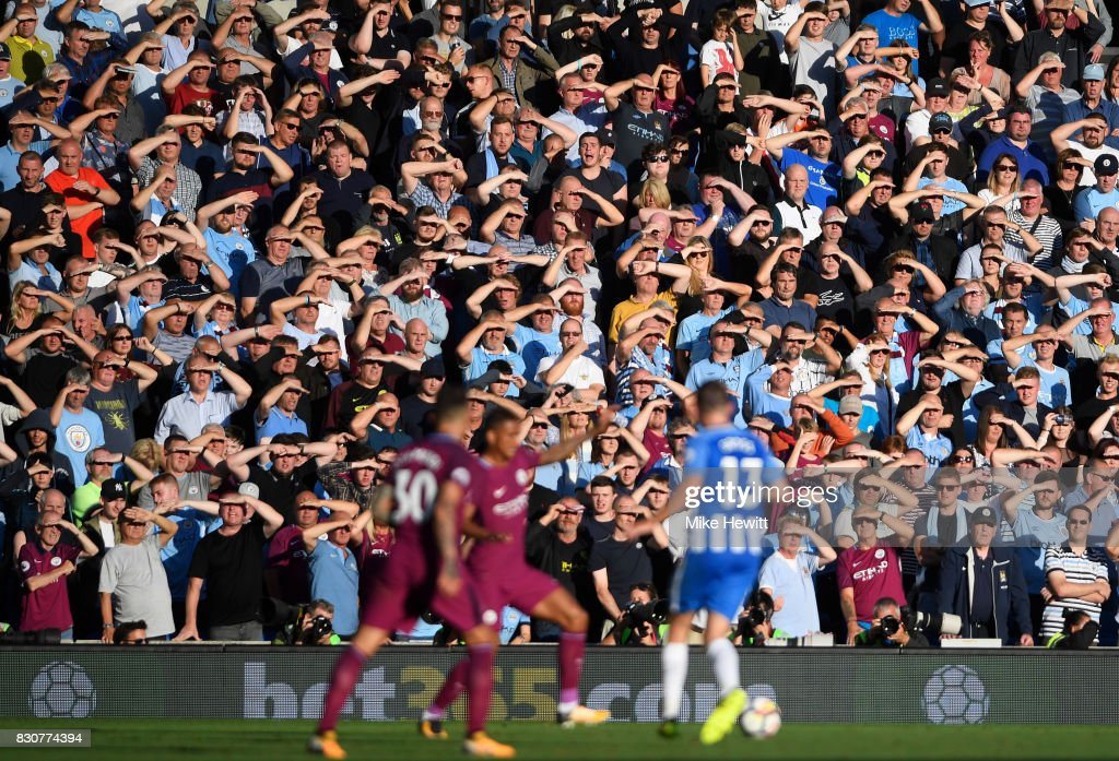 Manchester City fans watch the game during the Premier League match between Brighton and Hove Albion and Manchester City at the Amex Stadium on August 12, 2017 in Brighton, England.