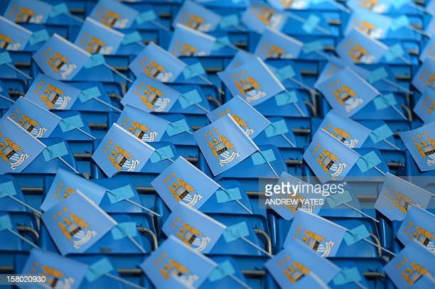 Manchester City flags for supporters are seen attached to seats before the English Premier League football match between Manchester City and...