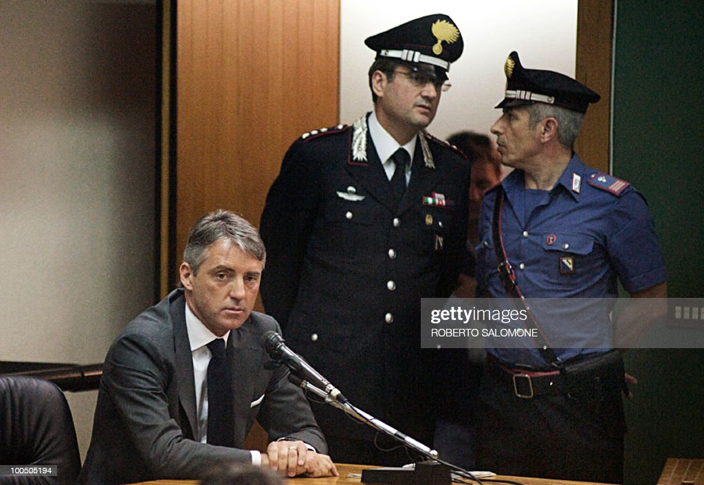 Manchester City Football Club's Italian manager Roberto Mancini (L, down) attends a hearing during the Calciopoli trial in the Palace of Justice of Naples on May 25, 2010. The inquest, led by FIGC prosecutor Stefano Palazzi, is related to the 2006 Calciopoli scandal that almost brought Italian football to its knees and resulted in several teams and individuals being punished for match-fixing.