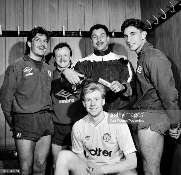 Manchester City footballer David Oldfield getting a haircut from his teammate Brian Gayle watched by Trevor Morley Neil McNab and Paul Lake at Maine...