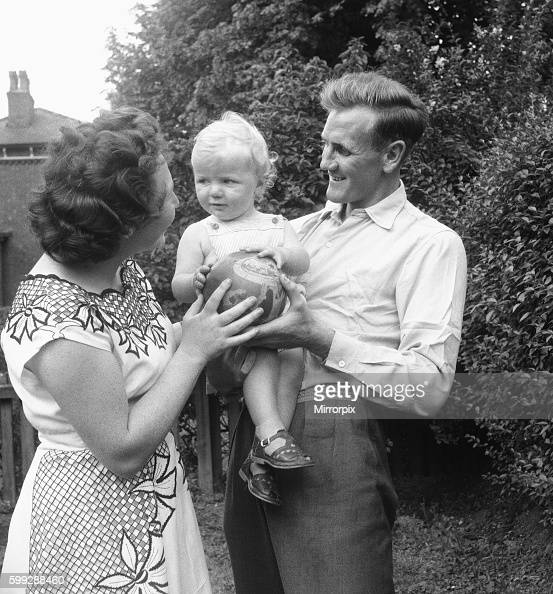 Manchester City footballer Don Revie pictured with his son Duncan and wife in the back garden of the family home 4th August 1955