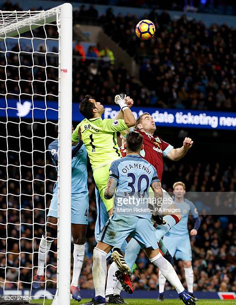 Manchester City goalkeeper Claudio Bravo attempts to punch the ball out before Burnley's Ben Mee scores during the Premier League match at the Etihad...